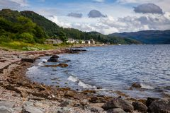 Scottish landscape with Tighnabruaich village on Kyles of Bute s. Tighnabruaich village on the Kyles of Bute narrow sea channel,  Cowal peninsula, Argyll and Royalty Free Stock Images
