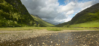 Scottish landscape with valley, mountains and river Stock Image