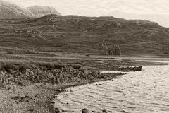 Scottish Loch and Mountains with Ruin Stock Photos