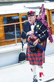 Scottish man with bagpipes and kilt Royalty Free Stock Photography