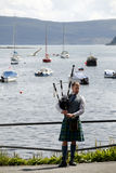 Scottish man with kilt and bagpipe Royalty Free Stock Photo