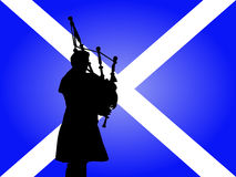 Scottish man playing bagpipes Stock Photo