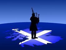 Scottish man playing bagpipes Stock Image
