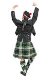 Scottish man in traditional national costume back posing Royalty Free Stock Photography