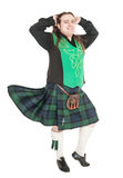Scottish man in traditional national costume with blowing kilt Royalty Free Stock Photos