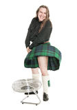 Scottish man in traditional national costume with blowing kilt Stock Photography