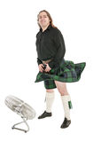Scottish man in traditional national costume with blowing kilt Stock Photos