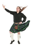 Scottish man in traditional national costume with blowing kilt Royalty Free Stock Photography
