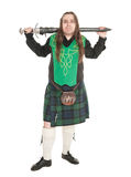 Scottish man in traditional national costume with sword Stock Photography