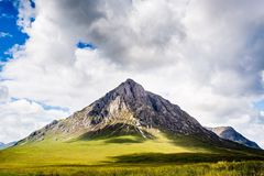 Scottish Mountain. A photo of Buachaille Etive Mor at the entrance to Glencoe in Scotland on a hot summer day royalty free stock images