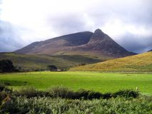 Scottish Mountains. A mountain in Scotland, (actually on the isle of Arran), amid a rural scene and farmland stock photos