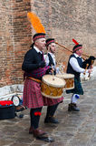 Scottish Musical Band. Venice, Italy-February 18, 2012: Traditional Scottish musical band performing in front of a brick wall in a square in Venice during the Stock Photo