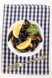 Scottish mussels, cooked in white wine sauce, with lemon and par Stock Photo