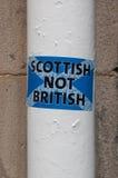 Scottish not British sticker on a white pole  Royalty Free Stock Images