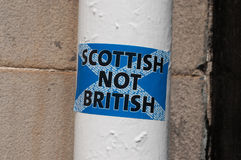 Scottish not British sticker on a white pole in a Scottish street Royalty Free Stock Image