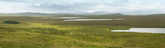 Scottish panoramic landscape with loch and moorland. Lewis isle Royalty Free Stock Images