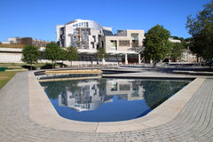 Scottish Parliament Front View. Front view of the Scottish parliament with the modern design reflected in the water feature at the front of the building royalty free stock images