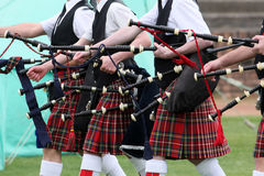 Scottish pipe band. Bodies of people in pipe band marching with traditional kilts and bagpipes at Highland games, Scotland Stock Photography