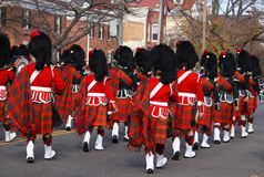 Scottish pipe and drum band. Pipe and drum band performing during the 37th annual Scottish Christmas Walk parade in City of Alexandria Old Town Washington DC Royalty Free Stock Image