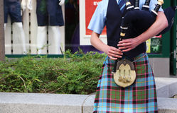 Scottish Piper on the Bagpipes Stock Photos