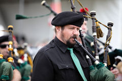 Scottish Piper in Band Stock Images