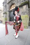 Scottish piper in Edinburgh Stock Photos