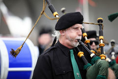 Scottish Piper. Playing in band in a parade at the 2013 Rio Grande Valley Celtic Festival in Albuquerque, New Mexico Stock Image