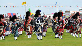 Scottish Pipes parade at Nairn Highland Games. Scottish Pipes Parade at Traditional Nairn Highland Games near Inverness Royalty Free Stock Photo