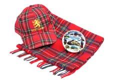 Scottish Red tartan cap, tartan scarves and souvenir plate Royalty Free Stock Images