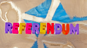 Scottish referendum. Referendum , about independence, in colorful uppercase letters on a silver background showing the Scottish flag, the Saltire Stock Images