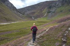 Female hiker walks in Cairngorm Mountains. Glen Esk Angus, Scotland royalty free stock photos