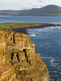 Scottish seaside cliffs. A view of dramatic seaside cliffs on the coast of Scotland near Orkney Stock Photos
