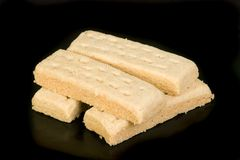 Scottish shortbread. Scottish butter shortbread biscuits fingers on a black background Royalty Free Stock Image