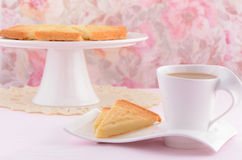 Scottish shortbread with tea. Freshly baked Scottish shortbread on white china with tea Stock Photos