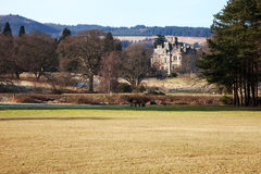 Scottish Stately Home. A large stately home on a hillside near Loch Lomond, Scotland royalty free stock images