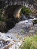 Scottish Stone Bridge. A bridge of stone over a very fast running highland stream stock photography