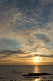 Scottish sunrise at sea. Sunrise over the Firth of Forth, Scotland, UK, Europe, with shoreline of Pittenweem, East Neuk, Fife, in the foreground Stock Photography