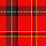 Scottish tartan. A detailed macro of classical Scottish tartan, red, black, yellow , white Royalty Free Stock Image