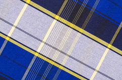 Scottish tartan pattern. Blue and white with yellow plaid print as background. Stock Images