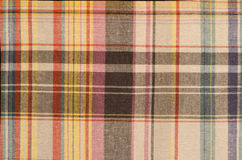 Scottish tartan pattern. Orange and brown with yellow plaid print as background. Royalty Free Stock Photo