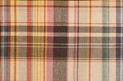 Scottish tartan pattern. Orange and brown with yellow plaid print as background. Royalty Free Stock Photo