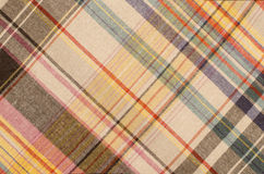Scottish tartan pattern. Orange and green with yellow plaid print as background. Royalty Free Stock Photos