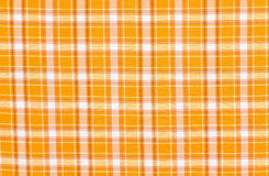 Scottish tartan pattern. Orange with white plaid print as background. Royalty Free Stock Photography