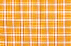 Scottish tartan pattern. Orange with white plaid print as background. Royalty Free Stock Photography