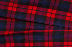Scottish tartan pattern. Red plaid print as background. Stock Photos