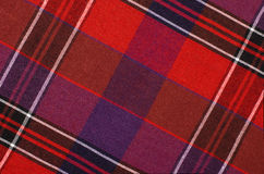 Scottish tartan pattern. Red and purple plaid print as background. Royalty Free Stock Photos