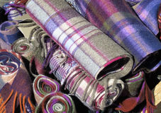 Scottish tartan for sale. Multicolored Scottish tartan scarfs for sale outside a shop Royalty Free Stock Photography