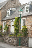 Scottish terraced cottage with roses Royalty Free Stock Photos