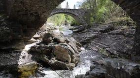 Scottish tourist attraction Invermoriston bridge built by Thomas Telford in 1813 to cross the River Moriston stock video footage