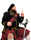 Scottish warrior with bottle of red wine Royalty Free Stock Photos